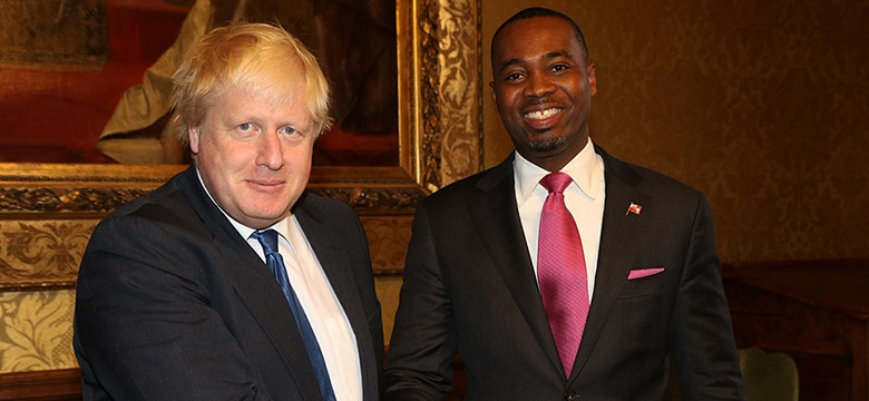 The Premier is pictured in two photos with the Foreign Secretary