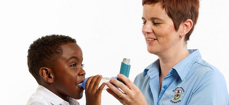 PHOTO: Asthma Nurse Deann Trott demonstrates the correct use of an inhaler and spacer.
