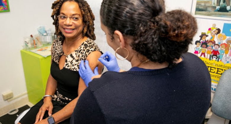 Minister Wilson getting a flu shot